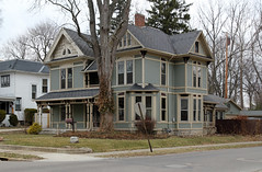 House - Urbana, OH (Pythaglio) Tags: county wood windows roof ohio house green bay victorian 11 historic diagonal porch frame urbana stick champaign siding ornate posts turned brackets lunette eastlake asbestos sprawling bargeboards strapwork