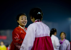 DANSEUSES AU BAL DU 15 AVRIL A PYONGYANG, COREE DU NORD (Eric Lafforgue Photography) Tags: voyage travel girls friends portrait woman color colour girl smile face smiling horizontal night happy dance asia dancers dress robe feminine femme smiles nighttime nightlight hanbok asie soiree custom soir 2008 nuit fille sourire couleur northkorea visage ideology axisofevil pyongyang eastasia feminin dprk toothysmile traditionalclothing arirang juche coleur northkorean festivites dictature democraticpeoplesrepublicofkorea northkoreans koreanpeninsula juchesocialistrepublic coreedunord rdpc koreanethnicity insidenorthkorea lumiereartificielle eclairagedenuit joseonot