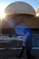 the sun, the moon, and the stars (Ian Muttoo) Tags: dsc80091edit toronto ontario canada gimp ufraw mclaughlinplanetarium backlit motionblur street walk planetarium sunstar lensflare architecture concrete midcenturymodernist midcentury modernist rom royalontariomuseum dome flare