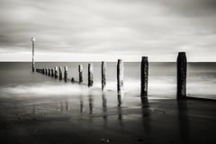 winters beach (jonbawden50) Tags: beach long exposure black white teignmouth sand reflections