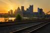 Illuminated Tracks (Brad Truxell) Tags: pittsburgh sunrise sunlight city buildings traintracks railroad river exposureblending hdr nikond7000