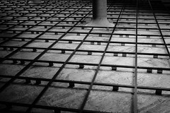 Tile Base (ep_jhu) Tags: lines x100f washington metro repetition abstract dc fujifilm upsidedown wmata tiles crystalcity ceiling dark fuji bw squares lookingup frame acros column arlington virginia unitedstates us