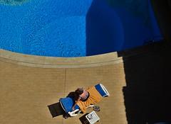 Una donna si gode la bella vita, la sua (camillamontesi) Tags: taormina sicilia italia italy swimmingpool summer woman portrait colorlife life human streetphotography house nikon