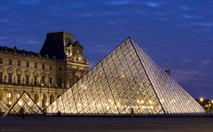 Louvre Pyramid at Night (Masoud Najari) Tags: paris louvre louvrepyramid attraction holiday visiting trip night nightphotography lowlightphoto availablelight simplearchitecture travel museum dark dusk golden cloudy nikon d7200 50mm f16 dslr photography lens sunset downtown tourist touristy march blue city yellow nightsbestimages warm