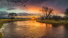 Easter in the river valley (piotrekfil) Tags: nature landscape river sunset dusk twilight reflections sky clouds sun meadow pentax poland piotrfil