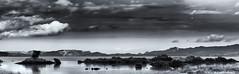 Moody Sky (muzza_buck) Tags: panorama 100mm newzealand auckland skyscape landscape sea water clouds blackwhite moody dark foreboding storm