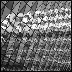 Reflective architecture - up close (ShimmeringGrains) Tags: square kiaula h281 planar8028 scannad mediumformat 6x6 bw kodakhc110b film zeissplanar8028 blackandwhite analogue ilford 120film mellanformat svartvitt hasselblad500cm hasselblad kvadrat kodakhc110 scanned analog ilfordhp5 karolinskainstitutet stockholm sweden reflective abstractarchitecture innovativearchitecture monochrome