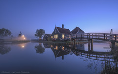 Blue hour at Zaanse Schans - Windmill Village - Netherlands (Light Levels Photoworks) Tags: zaanse schans windmill village moulin nederland holland hollande niederland architecture architektur amsterdam landscape landschaft paysage hauser haus dämmerung water wasser nacht kanal beleuchtung blue blaue bridge brücke before d750 dusk dust hdr nebel brouillard wetter perspectives light lights night nightshot nikon licht time nikond750 lichter lzb morning hour photo photography river reflexion stunde spiegelung twillight view travel world wideangle sweet fluss sonnenuntergang europe europa sunlight romantic romantik dorf windmühle
