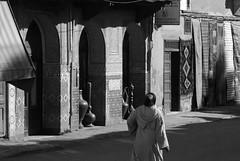 pass the wine jar (diminoc) Tags: marrakech morocco streetphotography blackandwhite bnw noiretblanc monocolour