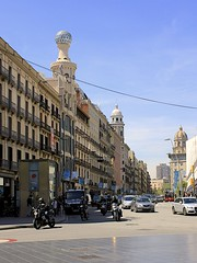 Carrer de Pelai (oxfordblues84) Tags: barcelona street sky building cars architecture clouds spain balcony motorcycles streetscene catalonia dome motorcycle catalunya domes railings carrerdepelai caclothingstore carrerdepelai55