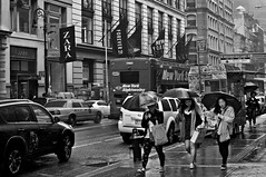 New York on a rainy day | 2013 (acharyyajoy) Tags: street blackandwhite bw newyork rain umbrella walking rainyday streetphotography peoples streetshot acharyyajoy joyacharyya