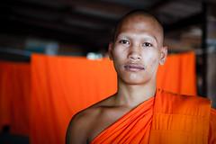 Monk at Pak Khwae (Lil [Kristen Elsby]) Tags: travel portrait orange closeup thailand asia buddhist monk buddhism monastery topv3333 saffron sukhothai buddhistmonk environmentalportrait travelphotography environmentalportraiture saffronrobes orangerobes canon5dmarkii pakkhwae diningrobe