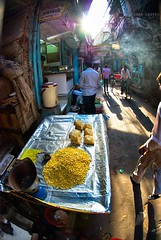 Sunlight and steaming corn (Soma Images) Tags: street new old travel light sun sunlight india jason streets up look walking photography back corn warm shine bright market delhi indian muslim crowd photojournalism images steam commercial license use vendor soma hindu cultural hindi crowded steaming backstreets vendors chandni chowk somaimages somaimagescom