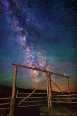 "Which is the better Milky Way photo? (IronRodArt - Royce Bair (""Star Shooter"")) Tags: nightphotography sky night fence stars landscape evening gate heaven glow nightscape astro astronomy starry nightscapes milkyway grandtetonnationalpark trian"