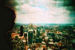 far away city (fotobes) Tags: city sky man london window silhouette skyscraper buildings lca xpro eyelashes bokeh crossprocess profile grain analogue expired shard vignette expiredfilm kodakelitechrome100 theshard hodachrome