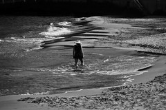 Walk in peace (Antonis Kourkoumelakis) Tags: street sea woman beach monochrome blackwhite nikon greece human crete chania 55200mm 2013 d3100