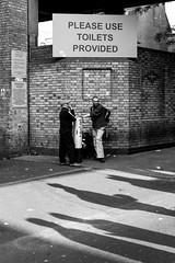 Please use the Toilets Provided (Torsten Reimer) Tags: uk england people blackandwhite signs men london shadows unitedkingdom candid streetphotography brickwall shoreditch bricklane toilets