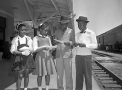 Unidentified children at the railroad depot in Tallahassee, Florida (State Library and Archives of Florida) Tags: children florida trains 1960s tallahassee railroads unidentified leoncounty railroaddepots africanamericanchildren statelibraryandarchivesofflorida tallahasseedemocrattallahasseefloridanewspaper tallahasseerailroaddepot