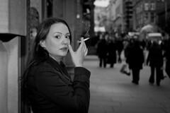 A Startled Smoker (Leanne Boulton) Tags: life street city portrait people urban bw woman white black monochrome canon scotland blackwhite pretty expression