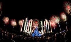 Christmas In The Air (Mark Willard) Tags: christmas longexposure holiday color castle night season orlando nikon mainstreet florida fireworks spirit crowd fisheye wishes cinderella burst wdw waltdisneyworld pyro celebrate magickingdom pyrotechnics perimeter d600