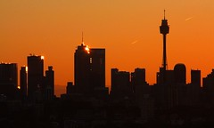 Sunset silhouette skyline (Sydney) (fotoeins) Tags: travel sunset sky orange silhouette skyline canon eos contrail streak sydney australia cbd xsi doverheights eos450d henrylee canonef70300mmf456isusm 450d fotoeins henrylflee fotoeinscom