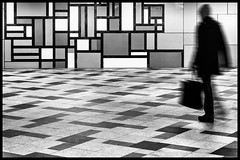 A geometric world (Ulrich Neitzel) Tags: bw bewegungsunschärfe geometric hamburg kacheln mzuiko1250mm monochrome motionblur muster olympusem5 pattern person schwarzweiss subway tiles ubahn underpass wandsbekmarkt