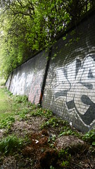 Former railway retaining wall by Bradford Rd overbridge, Deighton, Huddersfield    (Huddersfield   Newtown - Mirfield    old railway) (dave_attrill) Tags: huddersfield newtown hillhouse mirfield lmsr london midland scottish railway disused line goods only branch trackbed west yorkshire riding cycle path foothpath ncn connection sheffieldtobradford bradford rd road overbridge bridge deighton retaining wall