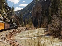 """Comin' Around the Mountain"" (Rev.Gregory) Tags: silverton durango historic train coal rail river mountain pass bend rocks trees sky"
