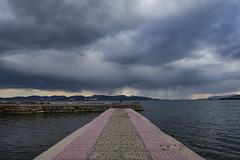 Rain showers above the sea horizon (panos_adgr) Tags: rain landscape sea nikon d7200 aspropyrgos greece attica dock water clouds winter ships