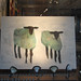 Black-faced sheep in painting