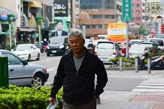 Passing Bloke (Bob Hawley) Tags: asia taiwan nikond7100 kaohsiung nikon70210mmf456afd people men streetscenes cities outdoors