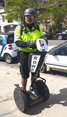 Meter Maid (photographyguy) Tags: car2go metermaid segway colorado denver grantst uptowndenver transportation parking sidewalk helmet cellphonephotography