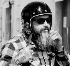Eight lives, one to die (Saul_Good) Tags: paultyronethomas biker angel helmet beard grey man sunglass tattoo zombie garage motor cycle rally hell hells checked shirt sunglasses iron bike