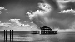Storm On The Horizon (Fourteenfoottiger) Tags: fujixt1 wideangle view flying birds light dramatic water structure westpier westpierbrighton storm stormy clouds weather dark moody mono monochrome blackandwhite seascape ruins abandoned sea seaside atmospheric contrast pier old aged
