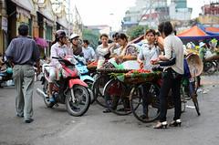 Marketing Skills (Sirio Timossi) Tags: street city girls urban vegetables bicycle composition photography town nikon women market tomatoes vietnam hanoi veg today selling customs sirio d7000 timossi siriotimossicom
