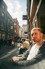 00A20016 (Tara Holland) Tags: people london film analog ginger sitting cousins sit thom coventgarden analogue seated sunnyday spud