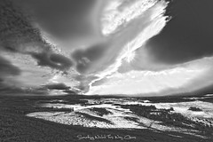 Something Wicked This Way Comes T (H.B. Mejia) Tags: winter blackandwhite sun canada spectacular landscape alberta stunning winterweather blackandwhitephotography sunstar impendingstorm southernalberta menacingclouds dramaticweather stunningphotography spectacularphotography rollingstorm