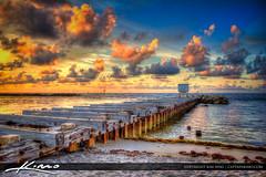 Pilings at the Hillsboro Inlet in Pompano Beach (Captain Kimo) Tags: ocean sunrise florida jetty atlantic pilings pompanobeach browardcounty hillsboroinlet photomatixpro hdrphotography captainkimo