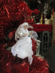 Christmas angel (Ruth and Dave) Tags: christmas red tree window shop vancouver mainstreet doll display mountpleasant decoration ornament tinsel