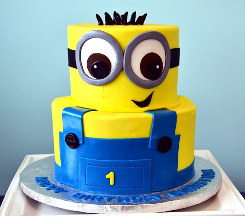 Minion holding a birthday cake! by Strawberry Lane Cake Company