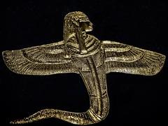 Gold human-headed Uraeus amulet representing the goddess Weret-Hekau found at the neck of Tutankhamun's mummy New Kingdom 18th Dynasty Egypt 1332-1323 BCE (mharrsch) Tags: werethekau uraeus gold pharaoh king ruler tutankhamun burial tomb funerary 18thdynasty newkingdom egypt 14thcenturybce ancient discoveryofkingtut exhibit newyork mharrsch premierexhibits amulet