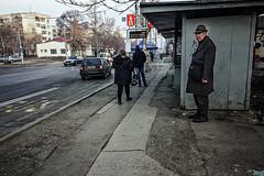 Pause (Melissa Maples) Tags: софия sofia българия bulgaria europe apple iphone iphone6 cameraphone winter traffic street road busshelter busstop bulgarian elderly man grey