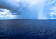 storm in the distance (-gregg-) Tags: ocean storm clouds blue rain cruise