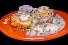 Restaurante La Muralla - Patatas a la importancia en salsa verde con almejas y gambas