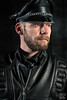 Tom in Black Leather, color version (WF portraits) Tags: aut man male portrait onlocation beard gaybeard leather gayleather black cap fetish fetishgear gayfetish