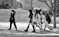 Cosplay Convention Strut (burnt dirt) Tags: houston texas downtown city town mainstreet street sidewalk streetphotography fujifilm xt1 bw blackandwhite girl woman people person animae cosplay costume uniform matsuri convention asian group crowd boots heels shortskirt longhair man purse bag backpack stockings fishnets blackstockings fishnetstockings facemask curlyhair shorts walking discoverygreen georgerbrown