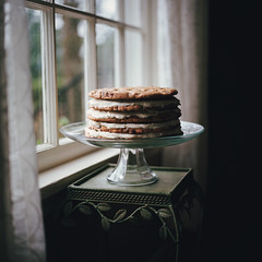 cookie cake (manyfires) Tags: film analog hasselblad hasselblad500cm square mediumformat cake cookie cookiecake chocolate chocolatechip windowlight window curtains house home lakeoswego cakestand food dessert sweets baked bake baking