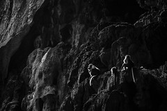 Side-lit monkey heist (haqiqimeraat) Tags: batucave malaysia kualalumpur monkeys cave rocks monochrome bw artistic composition