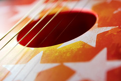 Down in a Hole (DaveLawler) Tags: sound hole guitar strings toy stars colorful instrument music musical macro monday macromonday