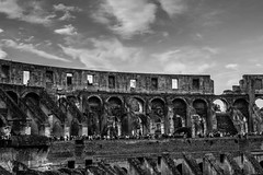 Inside The Colosseum (NikNak Allen) Tags: italy rome roman architecture building stadium arches old history ruins tourists tourism sky clouds black white blackandwhite grey light shadow
